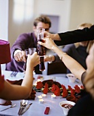 Young people chinking glasses of Kir Royal