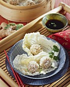 Asian rice balls on white cabbage leaves