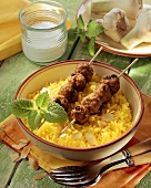 Mince kebabs on curried rice
