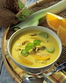 Orange and coconut soup with mince and leeks
