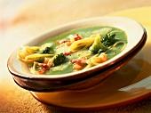 Broccoli soup with spaghettini and smoked bacon