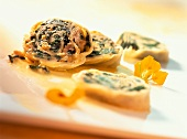 Pasta roulade with spinach and veal filling
