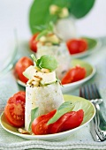 Avocado cheese flan with tomatoes, basil & pine nuts