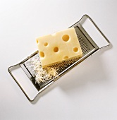 A piece of Emmental cheese on grater