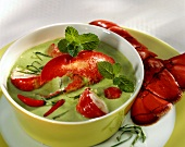 Cold green creamed pea soup with lobster