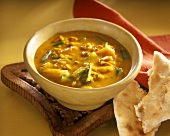 Yellow Indian soup with chicken breast & courgette strips