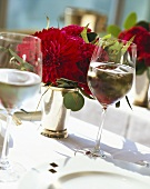 Laid table with flowers and wine glasses; close-up