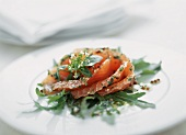 Exotically marinated Graved Lachs on rocket leaves