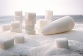 Sugar still life; crystal sugar, cube sugar & sugar loaf