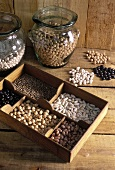 Dried pulses in typesetter's case and in jars