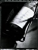 Bottle of 1990 Chateau Mouton Rothschild (b/w photo)