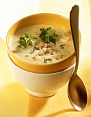 Creamy cauliflower soup with cashew nuts & chili rings