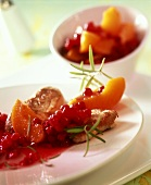 Pork medallions with peach and cranberry compote