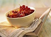 Apricot and redcurrant chutney in bowl