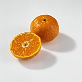 Whole and half mandarin (Clauselina)