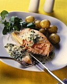 Sauteed salmon slice with caper sauce & new potatoes