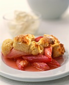 Rhubarb compote with ducat rolls; cream in background