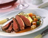 Lamb fillet, cut open, with mashed potato and vegetables