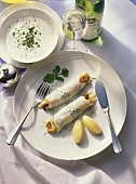 Steamed, stuffed fish rolls with chive sauce