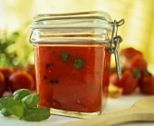 Spicy tomato and pepper sauce in preserving jar