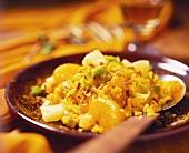 Spicy curry rice salad with orange segments, pineapple & leek