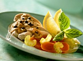 Chicken breast with tuna and caper sauce and vegetables