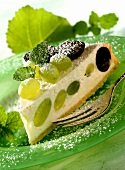 A piece of quark cake with grapes