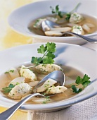 Clear asparagus soup with semolina dumplings
