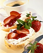 Muesli roll spread with low-fat strawberry quark