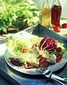 Mixed salad leaves with soft cheese and strawberries
