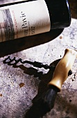 A bottle of 1937 Chateau Pavie, a corkscrew in front