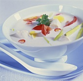 Thai coconut milk soup with chicken, tomatoes, lemon grass
