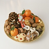 Colourful biscuit plate with mandarins, nuts, chocolate