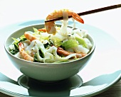 Broad Asian rice noodles with shrimps and vegetables