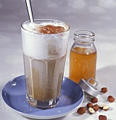 Latte macchiato flavoured with hazelnut syrup