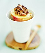 Baked peaches with amaretti stuffing in a beaker