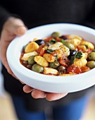 Gnocchi with tomato and olive sauce