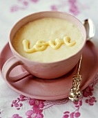 "Rice pudding with the word ""Love"" in cup"