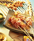 Raw chicken sate kebabs, marinated ready for grilling
