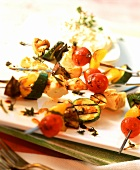 Barbecued vegetable kebabs with sheep's cheese