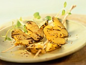 Potato kebabs with garlic oil, black cumin and sesame