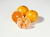 Clementines, two whole, one half and one peeled