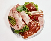 Platter with various sliced hams