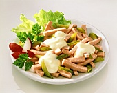 Sausage salad with gherkins and mayonnaise