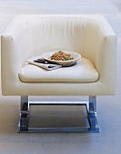 A plate of chick pea salad on white armchair