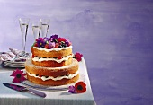 Tiered special occasion cake with lemon cream & berries