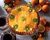 Fruit flan with oranges, mandarins and kiwi