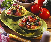 Avocado salad with tomatoes and olives in avocado halves