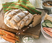 A loaf of yoghurt bread with vegetables, slice cut