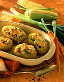 Potatoes au gratin stuffed with vegetables & chicken breast
